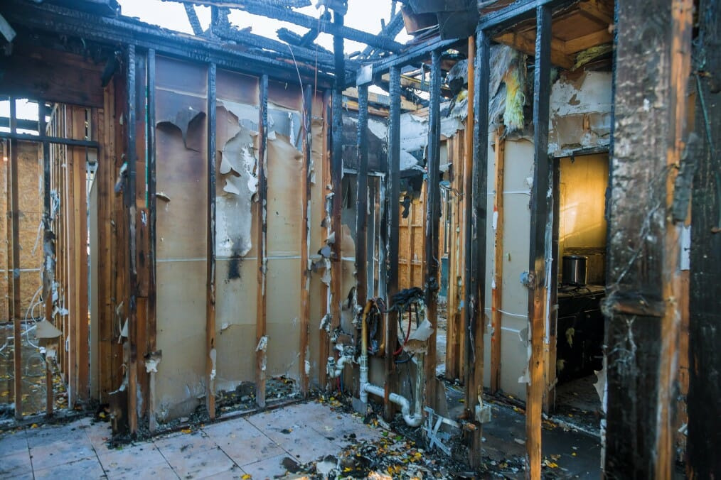 burnt wooden walls house with charred roof burnt fire damaged interior details t20 rR7vEd
